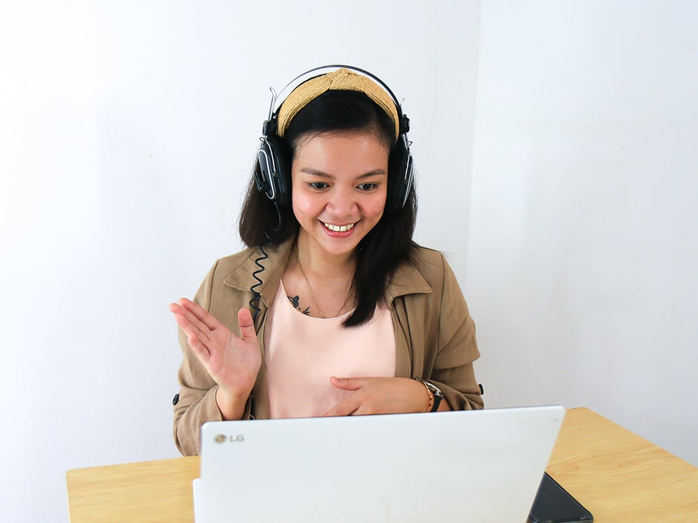 a student learning online with a laptop and headset