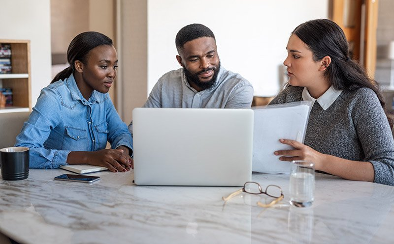 family looking at finances on laptop